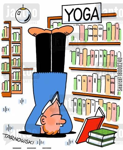 Man reading a yoga book while standing on his head.